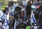 بسبب رفعها علم فلسطين… محكمة الاحتلال تمتد اعتقال هالة الشريف