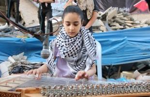 """غزة: """"الشباب والثقافة ومنتدى الأمة"""" ينظمان أمسية ثقافية على أنقاض برج هنادي"""