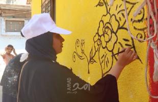 تنفيذ مبادرة مجتمعية لتجميل أحد الأحياء السكنية في النصيرات- فيديو